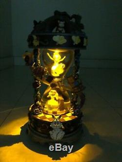 Disney Alice in Wonderland Hourglass Snowglobe and Music and Glitter. RARE Item