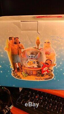 Disney Lilo & Stitch Elvis Musical Snowglobe Snow Globe. Plays the tune Aloha Oe