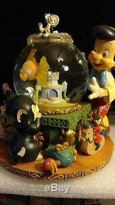 Disney Pinocchio Snow Globe RARE Toyland Musical/Animated