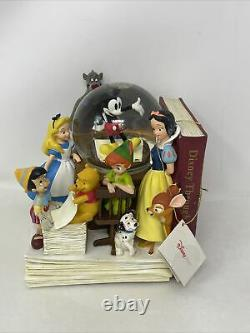 Disney Store Through The Years Vol. 1 Musical Snow Globe and Bookend