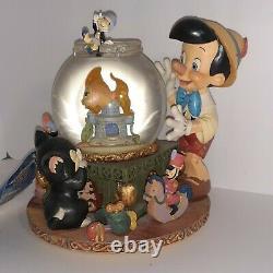 Pinocchio Toyland, Cleo in Fishbowl Musical Snowglobe. Disney Store