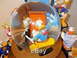 RARE Disney Donald Duck THROUGH THE YEARS Multi Figurines Musical SnowGlobe-MIB
