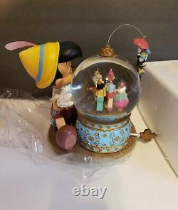 Rare Disney Pinocchio and Figaro Magic Musical Snow Globe Brahm's Waltz. NIB