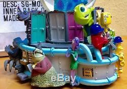 Walt Disney Pixar Monsters Inc Musical Snow Globe Monstropolis Snowglobe in Box